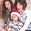 Mom reading a Christmas story with children. — Stock Photo #59014325