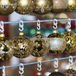 Christmas balls in a row, selective focus — Stock Photo #54002057
