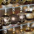 Christmas balls in a row, selective focus — Stock Photo #54002059