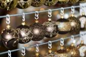 Christmas balls in a row, selective focus — Stock Photo