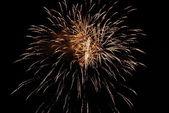 Golden orange amazing fireworks — Stock Photo