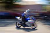 Biker with a motorcycle in motion blur  — Stockfoto