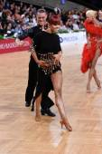 Latin american couple dancing at the competition — Stockfoto