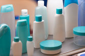 Plastic cosmetic containers, selective focus — Stock Photo