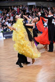 Ballroom dance couple, dancing at the competition — ストック写真