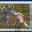 Olympic games Stamp with Fencing — Stock Photo #63984895