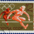 Olympic games Stamp with hurdles — Stock Photo #63985873