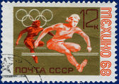 Olympic games Stamp with hurdles — Stock Photo