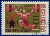 Olympic games Stamp with weightlifter — Stock Photo