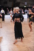 Female latin dancer dancing during competition — Stock Photo
