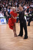 Latin american couple dancing at the competition — Stock Photo