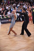 Latin american couple dancing at the competition — Stok fotoğraf