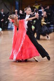 Ballroom dance couple, dancing at the competition — Stock Photo