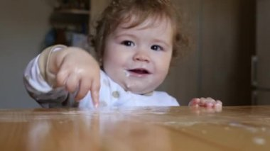 Baby playing with flour — Stockvideo