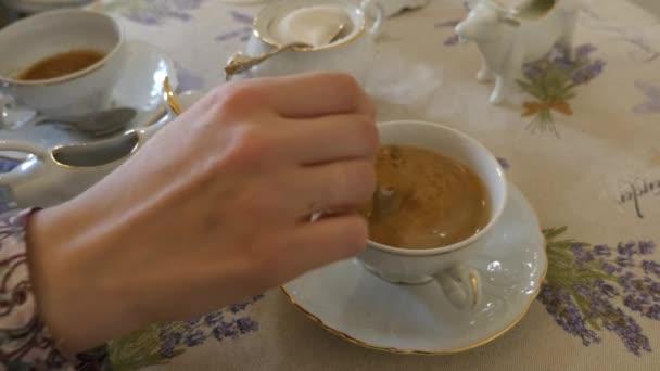Woman stiring coffee — Vídeo de stock