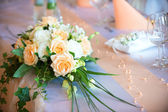 Flower bouquet  on wedding dining table — Stock Photo