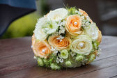 Wedding bouquet on a wood surface — Stock Photo