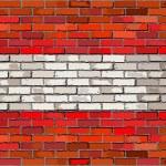 Grunge flag of Austria on a brick wall — Stock Vector #78132182