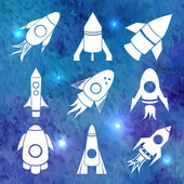White rockets icons on watercolor background — Stock Vector