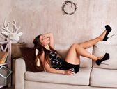 Happy girl on the couch. — Stock Photo