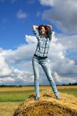 Woman on haystack — Stock Photo