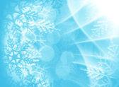 Blauwe kerstmis achtergrond met sneeuwvlokken — Stockfoto