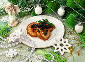 Fish fritters with caviar and Christmas decor — Stock Photo