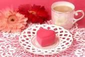 Cup of tea, heart-shaped box and gerbera flowers — Stock Photo