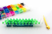 Colorful of elastic rainbow loom bands tool.  — Stock Photo