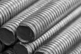 Stack of round steel bar - iron metal rail lines material . — Stock Photo
