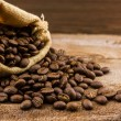 Brown roasted coffee beans in canvas sack. — Stock Photo #58027705