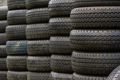 Stack of old wheel black tyre. — Stock Photo