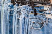 Row of Jeans and trousers on hangers. — Stock Photo