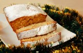 Christmas cake with sugar powder on white plate — Stock Photo