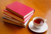 Cup of tea and stack of books  — Stock Photo