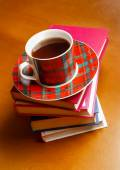Cup of tea and stack of books  — 图库照片
