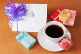 Blank greeting card with bow,  colored gift boxes  and white cof — Stockfoto