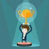 Businessman holding golden trophy — Cтоковый вектор
