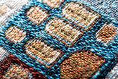 Colorful gobelin tapestry texture macro — Stock Photo