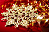 Golden snowflake and tinsel christmas background — Stock Photo