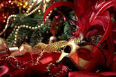 Magic Christmas background with golden carnival mask — Zdjęcie stockowe