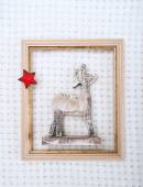 Christmas reindeer framed picture with  fur and red star — Stock Photo