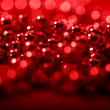 Red beads with blurred lights bokeh for Christmas atmosphere — Stock Photo #58690249