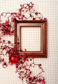 Classic wooden frame decorated with Christmas foil stars and red  ball — Fotografia Stock