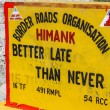 """Road Sign """"Better Late than Never""""-Ladakh,India — Stock Photo #63390487"""