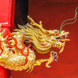 Golden Chinese Dragon on the Red Wall — Stock Photo #64077861