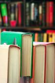 Books on wooden desk — Stock Photo