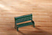 Bench on wooden table — Stock Photo