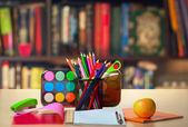 Pencils, copybook and apple — Stock Photo