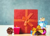 Christmas presents and  candle — Stock Photo